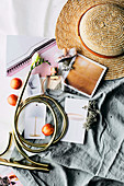 Summery mood board with straw hat and product photos