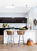 Two bar stools on a modern kitchen in black and white