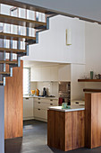 Fitted kitchen below staircase