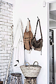 Wardrobe corner with wall hooks and stools with macrame decoration