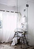 Vintage white bathroom with sink on old wooden trestle
