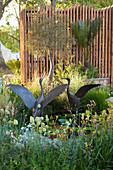 Bronze crane figure in the garden