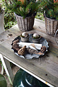 Cones, Candles, String And Pots With Snail Shells In Baking Dish