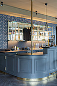 Open-plan, bar-style kitchen with grey panelled front