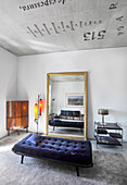 Couch, gilt-framed mirror, standard lamp, side table and corner cabinet
