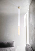Low hanging ceiling lamp in the minimalist living room