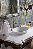 Modern marble sink on antique washstand