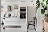 Large white kitchen-dining room with vintage-style accessories