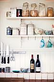 Storage jars and bowls on kitchen shelves