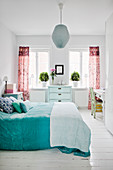 Pleasant white bedroom with colourful accents