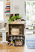 Old wooden crates used as kitchen counter with potted herbs on top