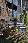 Old Wooden Table And Stool As A Seat In The Garden, Chrysanthemum In Bowl On The Table