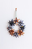 Christmas wreath of origami stars in grey and copper