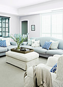 Bright, pastel-colored upholstered furniture in the living room