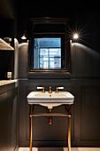 Vintage sink in dark bathroom