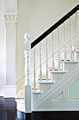 Artfully ornate handrail of a classic staircase