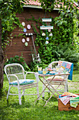 Set table in summery garden with colourful accessories