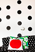 Black, DIY, polka-dot stickers on white wall above sofa