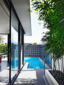 Corner swimming pool in the garden of a modern house