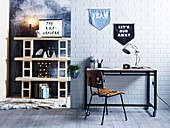 Industrial style desk on brick wall with pennants