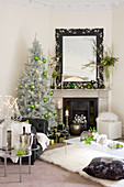 Festively decorated living room in black, white and green
