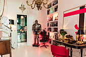 Bust on console table, suit of armour, shelves and antique table in anteroom