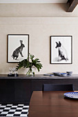 Two animal pictures above the sideboard in the dining room