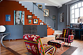 Kilim chairs in open-plan living space filled with assorted artwork