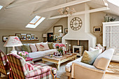 Fireplace, sofas and armchairs in attic living room