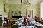 Wallpaper in dining room with French crystal chandelier