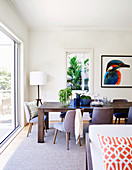 Gray upholstered chairs around the wooden table in the bright dining room