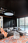 Living room with black walls and high ceilings