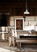 Rustic wooden table and bench, pendant lamp above