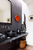 Ethnic style bathroom with gray wall and black decoration