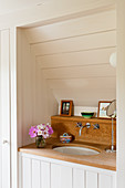 Oak washstand in wood-panelled alcove