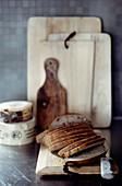 Sliced bread on rustic wooden board