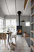Dog in dining room in natural shades with gallery in holiday home