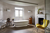 Yellow easy chair in classic bathroom with curved wall