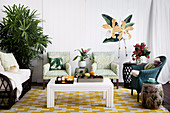 Various seating furniture, side tables, coffee table set and green plants in the living room
