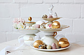 Easter eggs on cake stand made from vintage-style crockery