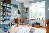 Grey-blue walls and vintage accessories in child's bedroom