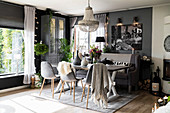 Cosy, Scandinavian-style dining room in shades of grey