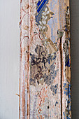 Detail of old wooden beam with traces of antique painted ornamentation
