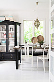 Old display case in vintage-style, black-and-white dining room
