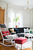 Rocking chair with footstool in rustic living room