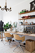 Two swivel chairs at desk with sewing machine and vintage accessories