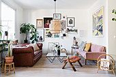 Open-plan, vintage-style living room with two sofas facing one another