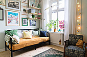 Sofa and gallery of pictures in cosy corner