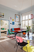 Colourful retro furniture in sunny interior of period building