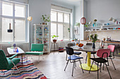 Colourful retro furniture in open-plan period interior